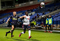 Bolton Wanderers' Arthur Gnahoua competing with Newcastle United U21's Jude Swailes (left) <br /> <br /> Photographer Andrew Kearns/CameraSport<br /> <br /> EFL Papa John's Trophy - Northern Section - Group C - Bolton Wanderers v Newcastle United U21 - Tuesday 17th November 2020 - University of Bolton Stadium - Bolton<br />  <br /> World Copyright © 2020 CameraSport. All rights reserved. 43 Linden Ave. Countesthorpe. Leicester. England. LE8 5PG - Tel: +44 (0) 116 277 4147 - admin@camerasport.com - www.camerasport.com