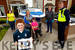 A Special delivery for Sean O'Mahoney in Cluan Ard by Garda Bryan English on Friday, as Sean would have been on his school tour with Blennerville NS. So the school organised a special treat of specially made cup cakes, to be delivered to all the children who could'nt travel on the trip,  <br /> Front right: Sean O'Mahoney.<br /> Back l to r: Debbie Moriarty, Georgina O'Mahoney, Cameron Donnelly, Bobby O'Connell (Principal) and Gda Bryan English.