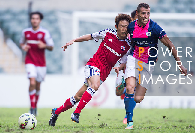 Yuto Nakamura of SCAA (L)  being followed by Fernando Recio Comi of Kitchee (R) during the HKFA Premier League between South China Athletic Association vs Kitchee at the Hong Kong Stadium on 23 November 2014 in Hong Kong, China. Photo by Aitor Alcalde / Power Sport Images