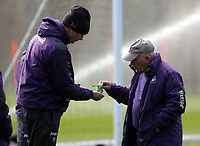 Head coach Paul Clement (L)takes a sweet from one of his colleagues during the Swansea City Training at The Fairwood Training Ground, Swansea, Wales, UK. Tuesday 04 April 2017