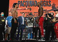 LAS VEGAS, NV - AUG 20:  Manny Pacquiao and Yordenis Ugas at the official weigh-in at the MGM Grand Garden Arena for the upcoming Fox Sports PBC pay-per-view fight night on August 20, 2021. The Pacquiao vs Ugas pay-per-view will be on August 21 at T-Mobile Arena in Las Vegas. (Photo by Scott Kirkland/Fox Sports/PictureGroup)