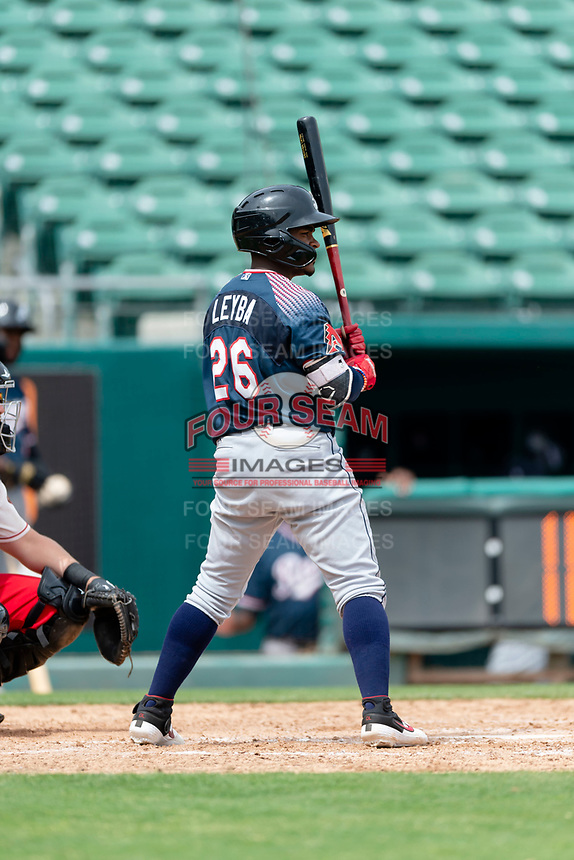 Reno Aces shortstop Domingo Leyba (26) hitting during a game against the Fresno Grizzlies at Chukchansi Park on April 8, 2019 in Fresno, California. Fresno defeated Reno 7-6. (Zachary Lucy/Four Seam Images)