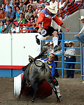 Bullfighter Lance Brittan makes a crowd pleasing jump with the assistance of fellow bullfighter Loyd Ketchum during the freestyle bullfight on July 29th at the Greeley Independence Stampede Rodeo in Greeley, Colorado.
