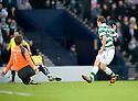CELTIC'S JAMES FORREST TRIES A SNEAKY LOOK AWAY AS HE TRIES TO CHIP FALKIRK'S MICHAEL MCGOVERN BUT HITS THE BALL STRAIGHT AT HIM