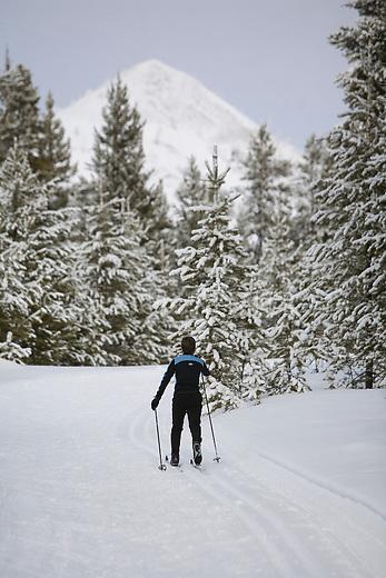Cross Country skiing at Haggin Mountain Ski Area near Anaconda, Montana with Haggin Mountain in the distance