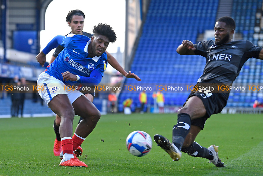 Cameron John of Doncaster Rovers right blocks the cross of Ellis Harrison of Portsmouth during Portsmouth vs Doncaster Rovers, Sky Bet EFL League 1 Football at Fratton Park on 17th October 2020