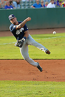 Taylor Brennan (12) of the Helena Brewers makes a throw to first base against the Ogden Raptors at Lindquist Field on July 23, 2013 in Ogden Utah. (Stephen Smith/Four Seam Images)