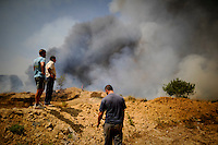 A group of people are seen around the fire area in Montserrat, on July 02, 2012, near Valencia.(c)  Pedro ARMESTRE