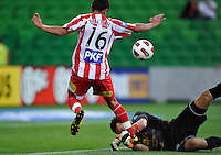 MELBOURNE, AUSTRALIA - JANUARY 09: Glen Moss of United  tackles Aziz Behich of the Heart during the round 23 A-League match between the Melbourne Heart and Gold Coast United at AAMI Park on January 19, 2011 in Melbourne, Australia. (Photo by Sydney Low / Asterisk Images)