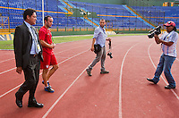 Landon Donovan (second from left) walks onto the track at Estadio Mateo Flores in Guatemala City, Guatemala before practice on Mon. June 11, 2012.