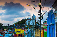Old church and colorful houses with messy electrical cables in the historic city of Olinda at sunset, in Pernambuco, near Recife Brazil