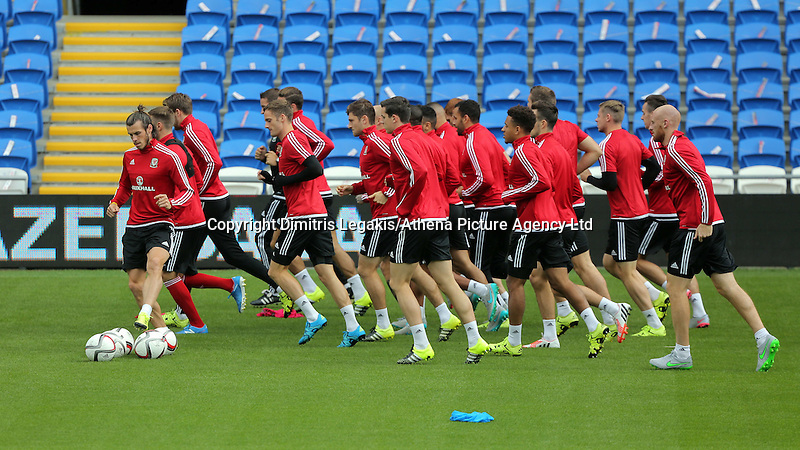 CARDIFF, WALES - SEPTEMBER 05: Gareth Bale (L) leads his team mates as they warm up during the Wales training session, ahead of the UEFA Euro 2016 qualifier against Israel, at the Cardiff City Stadium on September 5, 2015 in Cardiff, Wales.