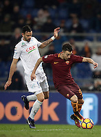 Calcio, Serie A: Roma vs ChievoVerona. Roma, stadio Olimpico, 22 settembre 2016.<br /> Roma's Stephan El Shaarawy, right, is challenged by Chievo Verona's Ivan Radovanovic during the Italian Serie A football match between Roma and Chievo Verona, at Rome's Olympic stadium, 22 December 2016.<br /> UPDATE IMAGES PRESS/Isabella Bonotto