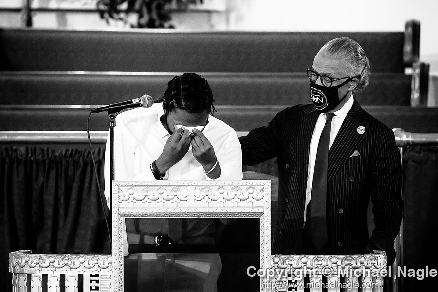 Dave Gardner Sr. is comforted by Al Sharpton as he speaks during the funeral for his one year-old son Davell Gardner Jr. on July 27, 2020 in the Brooklyn borough of New York City.  Gardner was shot and killed earlier this month during a cookout in front of his home along with three others.  Photograph by Michael Nagle