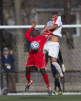 Rutgers University forward Ibrahim Kamara (9) and Boston College midfielder/defender Patrick Chin (9) battle for head ball.  Rutgers University defeated Boston College in penalty kicks after two overtime periods in NCAA Division I tournament action, at Newton Campus Field, November 20, 2011.