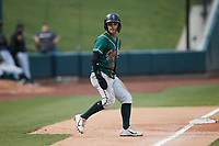 Nick Gonzales (2) of the Greensboro Grasshoppers takes his lead off of third base against the Winston-Salem Dash at Truist Stadium on August 11, 2021 in Winston-Salem, North Carolina. (Brian Westerholt/Four Seam Images)