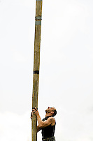 A competitor picks up a caber during the caber toss at the Loch Norman games in Huntersville, NC.