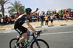 Sky Procycling rider Christian Knees (GER) waves to local school children before the start of the 3rd Stage of the 2012 Tour of Qatar running 146.5km from Dukhan Souq, Dukhan to Al Gharafa, Qatar. 7th February 2012.<br /> (Photo Eoin Clarke/Newsfile)