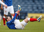 David Templeton holds his ankle after a lunge from Ian Watt