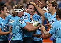 Waratah Matt Carraro , centre, celebrates his try against the Highlanders in the Super 15 rugby match, Forsyth Barr Stadium, Dunedin, New Zealand, Saturday, March 14, 2015. Credit: SNPA/Dianne Manson