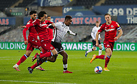 30th December 2020; Liberty Stadium, Swansea, Glamorgan, Wales; English Football League Championship Football, Swansea City versus Reading; Jamal Lowe of Swansea City holds off the challenge from Tom McIntyre of Reading FC
