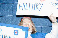 Campaign volunteer Nancy Richards-Stower, of Merrimack, NH, holds handwritten campaign signs before former Secretary of State and Democratic presidential candidate Hillary Rodham Clinton speaks at a rally at Nashua Community College in Nashua, New Hampshire, on Tues. Feb. 2, 2016. Former president Bill Clinton also spoke at the event. The day before, Hillary Clinton won the Iowa caucus by a small margin over Bernie Sanders.
