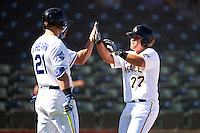 Surprise Saguaros Jin-De Jhang (77), of the Pittsburgh Pirates organization, high fives teammates Scott Heineman (7) and Ryan O'Hearn (21) after scoring a run during a game against the Salt River Rafters on October 17, 2016 at Surprise Stadium in Surprise, Arizona.  Surprise defeated Salt River 3-1.  (Mike Janes/Four Seam Images)