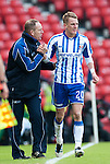 GLASGOW, SCOTLAND - JANUARY 28:  Killie manager congratulates his son Dean who has scored the winning goal during the Scottish Communities Cup Semi Final match between Ayr United and Kilmarnock at Hampden Park on January 28, 2012 in Glasgow, United Kingdom. (Photo by Rob Casey/Getty Images).