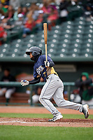 Burlington Bees shortstop Roberto Baldoquin (7) follows through on a swing during a game against the Great Lakes Loons on May 4, 2017 at Dow Diamond in Midland, Michigan.  Great Lakes defeated Burlington 2-1.  (Mike Janes/Four Seam Images)