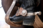 One of the most recognized names in the rodeo world, stock contractor Harry Vold of Avandale, Colorado, sports a pair of custom made spurs on his boots as he oversees action at the Cheyenne Frontier Days rodeo in Cheyenne, Wyoming.