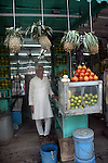 A man at his fruit juice stall in New market area of Kolkata. Street food stalls are serving the office goers for decades. All kind of Indian foods are available on the street at an affordable price. They sale them openly. Street food stalls are another results of unempoloyment and over poppulation. They serve millions of people in India. Kolkata, West Bengal,  India  7/18/2007.  Arindam Mukherjee/Landov