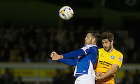 Tom Parkes of Bristol Rovers & Max Kretzschmar of Wycombe Wanderers go up for the ball during the Johnstone's Paint Trophy match between Bristol Rovers and Wycombe Wanderers at the Memorial Stadium, Bristol, England on 6 October 2015. Photo by Andy Rowland.