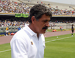 "UANL Tigres coach Ricardo ""Tuca"" Ferreti leaves the green after being expelled by the referee Roberto Garcia Orozco during the first half time of the soccer match between UNAM Pumas and UANL Tigres at the University Stadium in Mexico City, April 23, 2006. UNAM Pumas tied 1-1 to UANL Tigres. Photo by Javier Rodriguez"