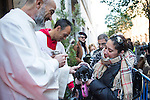 A dog is blessed by a priest at San Anton church in Madrid marking San Anton Abad's Day (Saint Anthony), on January 17, 2016. Pet animals, many dressed in their finest, trooped into churches across Spain in search of blessing on the patron saint of animals Saint Anthony's Day.  (ALTERPHOTOS/Rodrigo Jimenez)