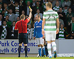 St Johnstone v Celtic...13.08.14  SPFL<br /> Dase Mackay is shown a yellow card by ref John Beaton<br /> Picture by Graeme Hart.<br /> Copyright Perthshire Picture Agency<br /> Tel: 01738 623350  Mobile: 07990 594431