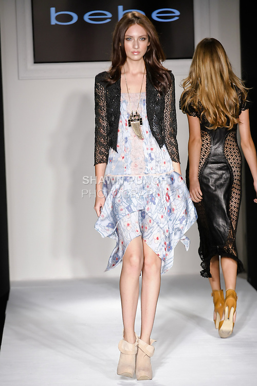 Model walks the runway in a bebe outfit, for the bebe Spring 2011 runway show with Style360, during New York Fashion Week Spring 2011, September 14, 2010.
