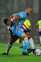 BARRANQUIILLA - COLOMBIA, 11-11-2018: German Gutierrez Henao (Izq) del Atlético Junior disputa el balón con Juan Pablo Zuluaga (Der) jugador de Jaguares de Córdoba durante partido por la fecha 19 de la Liga Águila II 2018 jugado en el estadio Romelio Martínez de la ciudad de Barranquilla. / German Gutierrez Henao (L) player of Atletico Junior struggles the ball with Juan Pablo Zuluaga (R) player of Jaguares de Cordoba during match for the date 19 of the Aguila League II 2018 played at Romelio Martinez stadium in Barranquilla city.  Photo: VizzorImage/ Alfonso Cervantes / Cont