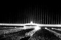 Grand review by political leaders on the searchlight-illuminated Zeppelin field in Nuremberg. September 1937<br /> <br /> Reichsparteitag. Der grosse Appell der Politischen Leiter auf der von Scheinwerfern uberstrahlten Zeppelin-wiese in Nurnburg.