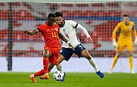8th Occtober 2020, Wembley Stadium, London, England;  Wales Rabbi Matondo holds off Englands Joe Gomez during a friendly match between England and Wales in London