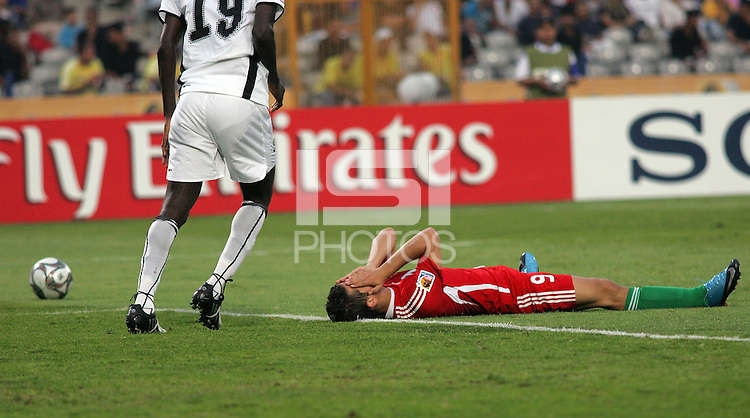 Hungary's Krisztian Nemeth (9) covers his face after falling to the ground after a failed goal attempt against Ghana during the FIFA Under 20 World Cup Semi-final match at the Cairo International Stadium in Cairo, Egypt, on October 13, 2009. Costa Rica won the match 1-2 in overtime play. Ghana won the match 3-2.