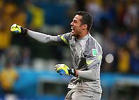 Brazil goalkeeper Julio Cesar celebrates his sides third goal by Oscar