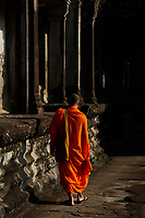A monk pose for photos in Angkor Wat ruins,  Siem Reap<br /> , Cambodia<br /> <br /> PHOTO :  Agence Quebec Presse<br /> <br /> <br /> <br /> <br /> <br /> PHOTO : Agence Quebec Presse