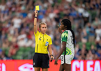 AUSTIN, TX - JUNE 16: Katja Koroleva gives a yellow card to Ijeoma Okonronkwo #12 of Nigeria during a game between Nigeria and USWNT at Q2 Stadium on June 16, 2021 in Austin, Texas.