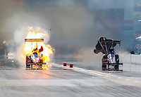 Oct 1, 2017; Madison , IL, USA; NHRA top fuel driver Doug Kalitta (left) explodes an engine on fire alongside Scott Palmer during the Midwest Nationals at Gateway Motorsports Park. Mandatory Credit: Mark J. Rebilas-USA TODAY Sports