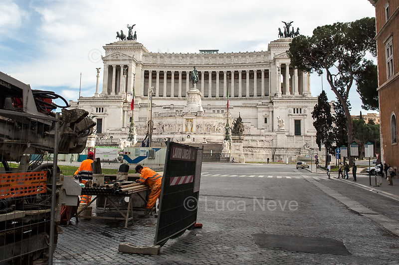 """Road workers: allowed.<br /> <br /> Altare della Patria - Vittoriano. <br /> <br /> Rome, 12/03/2020. Documenting Rome under the Italian Government lockdown for the Outbreak of the Coronavirus (SARS-CoV-2 - COVID-19) in Italy. On the evening of the 11 March 2020, the Italian Prime Minister, Giuseppe Conte, signed the March 11th Decree Law """"Step 4 Consolidation of 1 single Protection Zone for the entire national territory"""" (1.). The further urgent measures were taken """"in order to counter and contain the spread of the COVID-19 virus"""" on the same day when the WHO (World Health Organization, OMS in Italian) declared the coronavirus COVID-19 as a pandemic (2.).<br /> ISTAT (Italian Institute of Statistics) estimates that in Italy there are 50,724 homeless people. In Rome, around 20,000 people in fragile condition have asked for support. Moreover, there are 40,000 people who live in a state of housing emergency in Rome's municipality.<br /> March 11th Decree Law (1.): «[…] Retail commercial activities are suspended, with the exception of the food and basic necessities activities […] Newsagents, tobacconists, pharmacies and parapharmacies remain open. In any case, the interpersonal safety distance of one meter must be guaranteed. The activities of catering services (including bars, pubs, restaurants, ice cream shops, patisseries) are suspended […] Banking, financial and insurance services as well as the agricultural, livestock and agri-food processing sector, including the supply chains that supply goods and services, are guaranteed, […] The President of the Region can arrange the programming of the service provided by local public transport companies […]».<br /> Updates: on the 12.03.20 (6:00PM) in Italy there 14.955 positive cases; 1,439 patients have recovered; 1,266 died.<br /> <br /> Footnotes & Links:<br /> Info about COVID-19 in Italy: http://bit.do/fzRVu (ITA) - http://bit.do/fzRV5 (ENG)<br /> 1. March 11th Decree Law http://bit.do/fzREX (ITA) - http://bit.do/fzRFz"""
