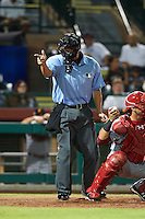 Umpire Chris Segal makes a call during an Arizona Fall League game between the Salt River Rafters and Scottsdale Scorpions on October 14, 2015 at Scottsdale Stadium in Scottsdale, Arizona.  Scottsdale defeated Salt River 13-3.  (Mike Janes/Four Seam Images)