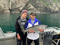 ALASKA FISHING <br />Whitney Grissom of Rogers and her son, Kayden, show a king salmon they caught during a fishing trip to Alaska in August. It's one of several salmon they caught on the trip near Seward, Alaska.<br />(Courtesy photo)
