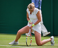 25-06-13, England, London,  AELTC, Wimbledon, Tennis, Wimbledon 2013, Day two, Michaella Krajicek (NED) on her knees<br /> <br /> <br /> <br /> Photo: Henk Koster