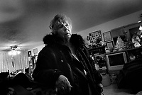 Alice Haburchak stands in her living room in Great Falls, Montana, a week after she suffered a minor stroke.  Though she quickly recovered almost fully, friends and family said she didn't seem to be quite herself until weeks later.