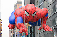 NEW YORK - NOVEMBER 25:  The Spiderman helium filled balloon floats overhead during the annual Macy's Thanksgiving Day Parade  on Thursday, November 25, 2010.